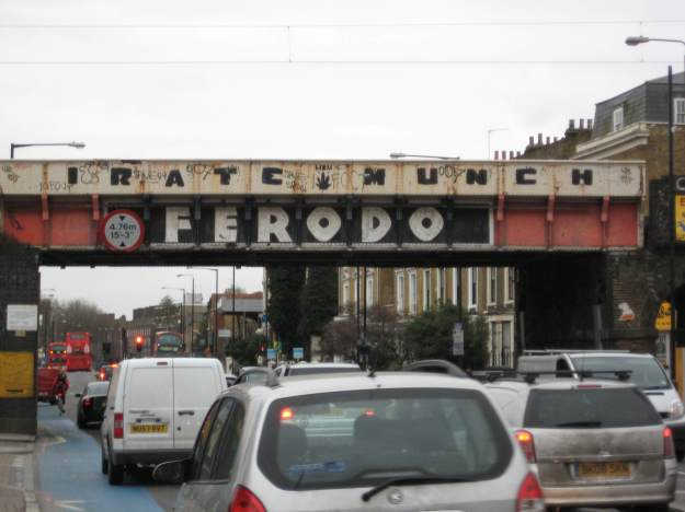 Irate Munch on the Ferodo Bridge, Bow Road.