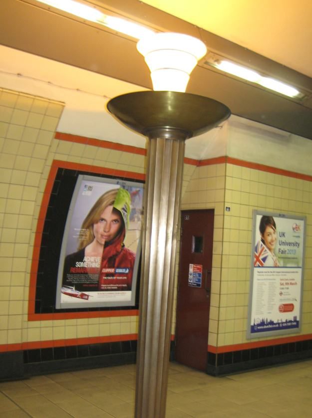 Forget achieving 'something remarkable' as the siren on the poster behind urges. Admire this underground column instead.