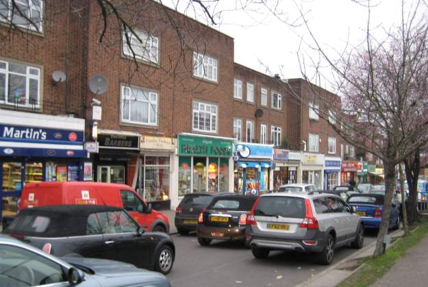 Well-presented parade of shops at well-presented Chigwell.
