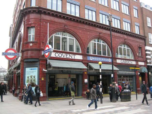 Covent Garden station. Leicester Square station off-stage right.