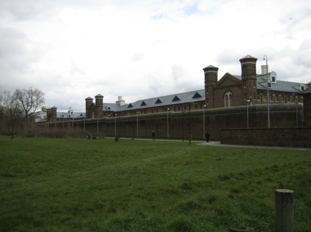 Wormwood Scrubs with canoodlers on bench.