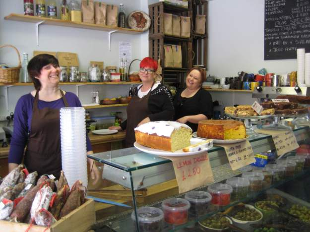 Aga's Little Deli: when only real, non-industrial cake (or cheese, off-camera to right - you didn't think I'd show you the cheese, did you?) will do. Gluten free Orange and Almond Cake recommended. Keep your hands off the morbier!