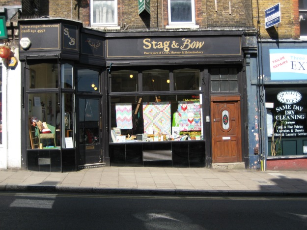 Stag & Bow - Purveyors of Craft, History & Haberdashery. The Inner Curmudgeon snorts. 'Call this a shop? Most times when I look in, all there is is half-a-dozen women sitting around drinking tea and knitting.' He shakes his head. 'Once it was half-a-dozen fellas drinking tea and knitting.'