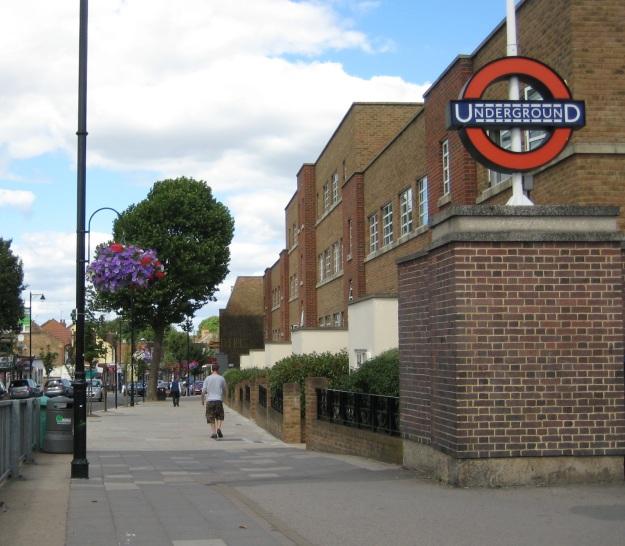 Hanging basket heaven and old-style Underground logo at Northfields.