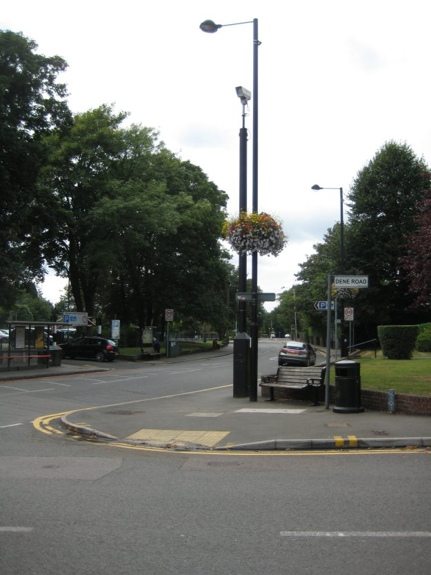 Landscape with bus shelter, street furniture, CCTV, benches and topiary.