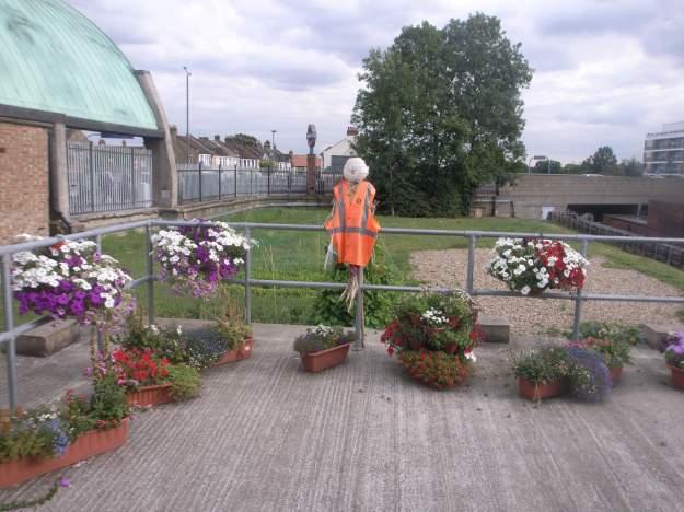 Installation: Garden with Scarecrow at Newtbury Park station.