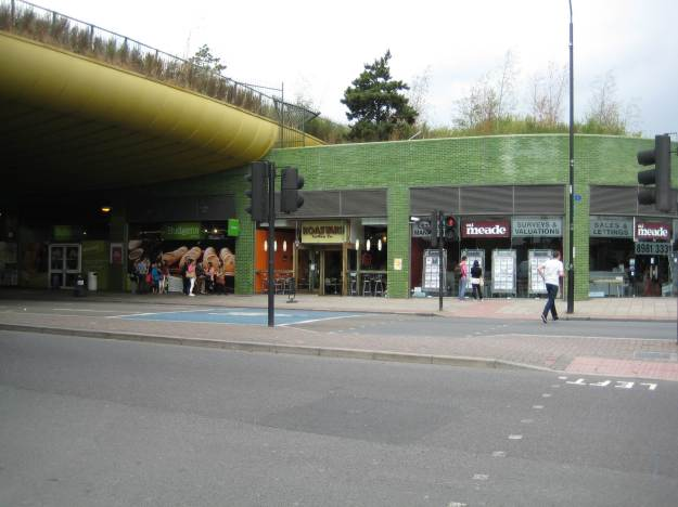 The Green Bridge, Mile End. Note - upmarket establishments under the bridge, your usuals down-market suspects by the station.