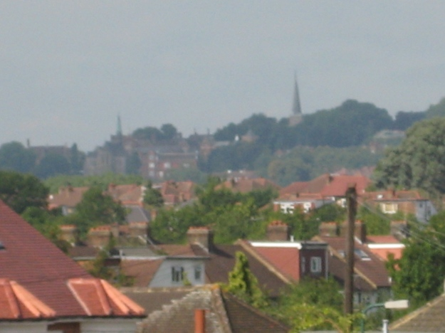 Murky view of Harrow School on the island rising above the Sargasso Sea of North West London Housing.