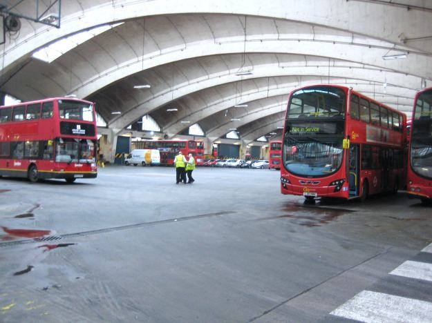 Inside the Grade 11* listed Stockwell Bus Garage. See those red things on wheels? Apparently, on payment of a small fee, you can board them and they will take you to different neighbourhoods around London.