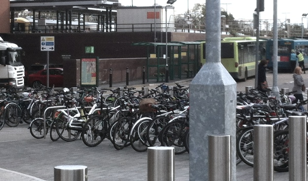 Bicycles - Northeners come to pick up their dole at Watford Junction.