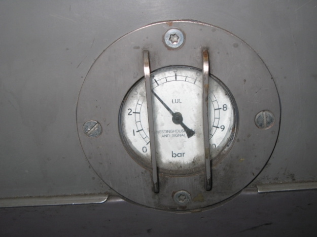 Public Service Photo - Central line brake pressure dial. Why it's here, I don't know. The Wee Professor stirs, And neither do I know why it's taken you the best part of 900 kilometres travelling on the Central line to spot one.