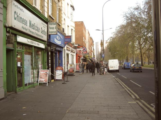 Boring view of old-time shops on Shepherd's Bush Green.
